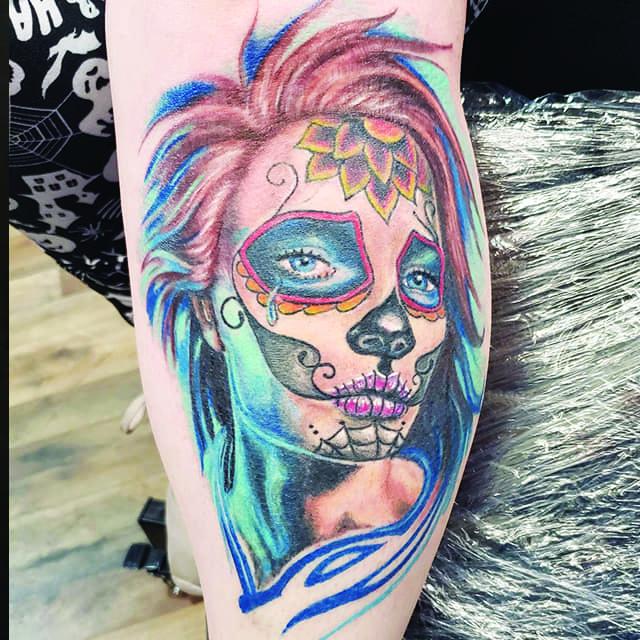 calf tattoo at sinning angels retro sugar skull